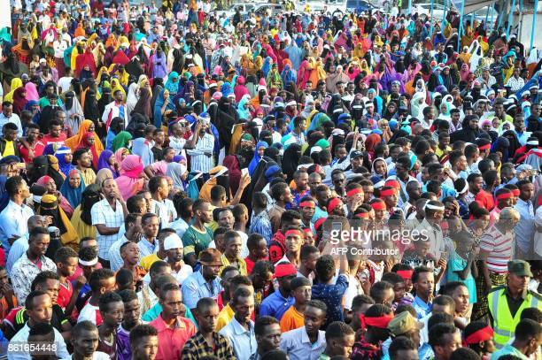 People protest against the deadly bomb attack in Mogadishu on October 15 after a truck bomb exploded outside of the Safari Hotel on a busy road...