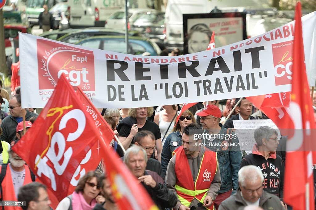 People protest against the government's labour market reforms in Rennes, northwestern France, on May 26, 2016. The French government's labour market proposals, which are designed to make it easier for companies to hire and fire, have sparked a series of nationwide protests and strikes over the past three months.