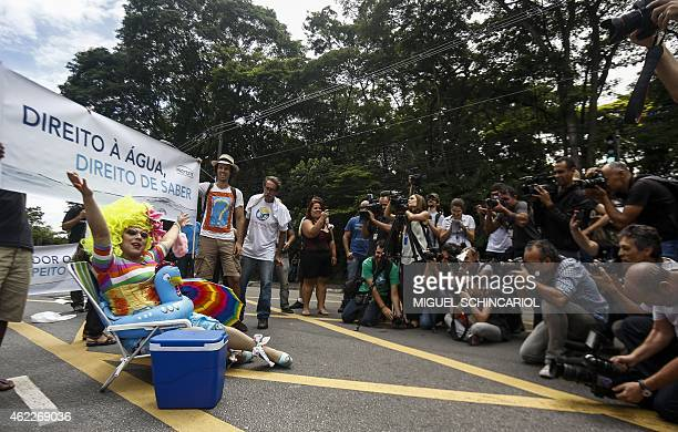 People protest against the lack of water in the city in front of the governmental palace in Sao Paulo Brazil on January 26 2015 The state of Sao...
