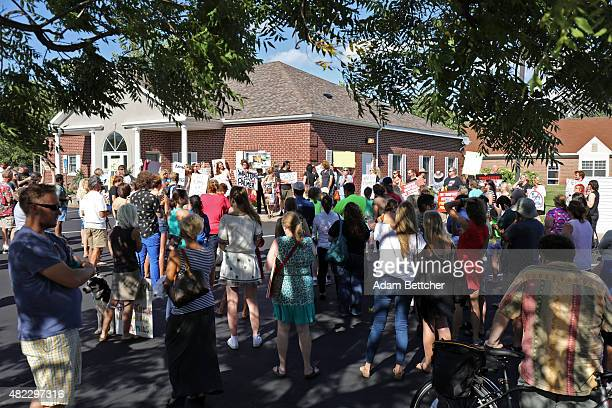 People protest against trophy hunting and poaching after the death of Cecil the lion in the parking lot of Dr Walter Palmer's River Bluff Dental...