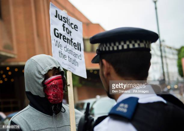 People protest ahead of a meeting of Kensington and Chelsea Council at Kensington Town Hall in west London where the future of the entire elected...