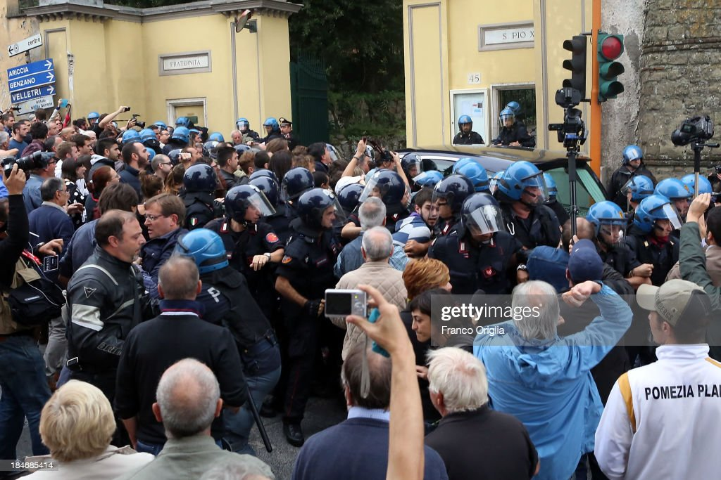 People protest as the car with the body of Erich Priebke arrives at the church of Lefebvriani on October 15, 2013 in Albano Laziale, Italy. The funeral of Erich Priebke, a former SS officer convicted of participating in the massacre of 335 citizens in Italy during World War II will now take place at the Lefebvriani Chapel in Albano Laziale, after the Catholic Church announced in a statement soon after his death that 'no public funeral would be granted to him in the city or outskirts of Rome'. His burial is not yet settled after his German hometown refused to allow his burial there.