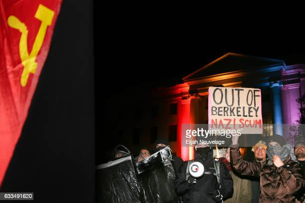 People protest controversial Breitbart writer Milo Yiannopoulos at UC Berkeley on February 1 2017 in Berkeley California A scheduled speech by...