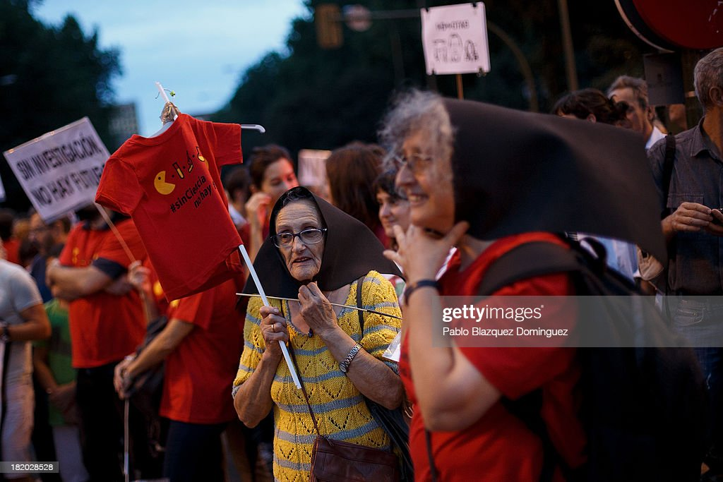People protest during a demonstration with other researchers against R&D cuts for sciences on September 27, 2013 in Madrid, Spain. Young Spanish scientists have called for a demonstration during the European Researchers' Night under the header, 'No Sciences, No Future', in response to cutbacks in research and development for Sciences. They claim that many Spanish researchers are leaving the country to find a jobs.