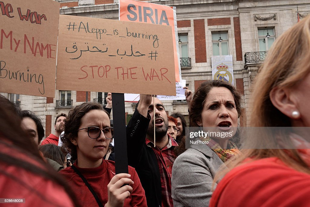People protest during the Worldwide red protest in Madrid on 6th May, 2016. The call of the Worldwide red protest denounces the systematic and indiscriminate attacks on hospitals and schools in the Syrian city of Aleppo.