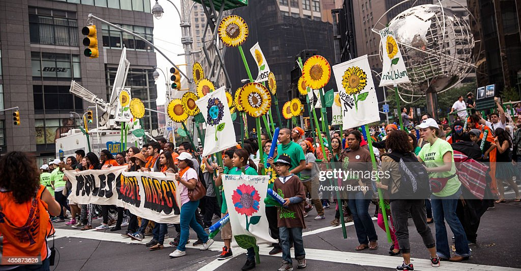 People protest for greater action against climate change during the People's Climate March on September 21 2014 in New York City The march which...