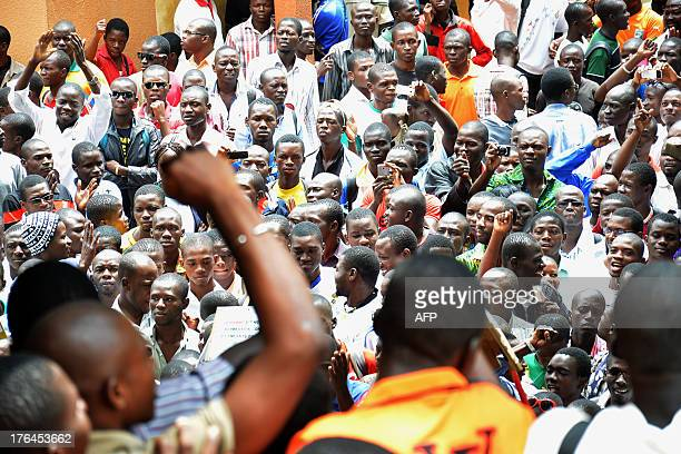 People protest in front of the court house of Ouagadougou on August 13 2013 where 50 students went on trial The students were arrested begining of...