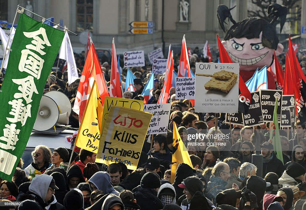People protest on November 28 2009 during a demonstration in Geneva against the upcoming ministerial meeting of the World Trade Organisation Swiss...