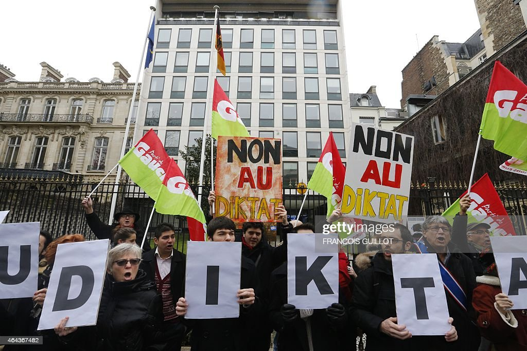 People protest outisde the German Embassy in Paris on February 25 2015 against the standoff between Berlin and Athens over proposals by the new Greek...