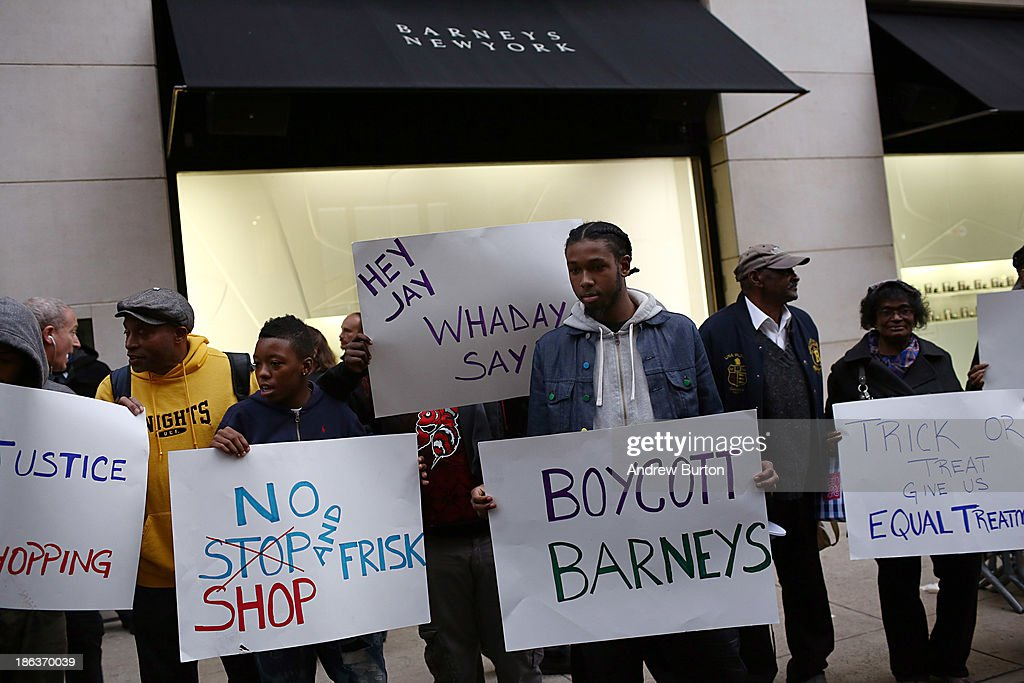 People protest outside Barney's flagship store, accusing the store of racial profiling, on October 30, 2013 in New York City. On April 29, 2013 Trayon Christian, 19, was detained and then arrested by undercover police after buying a $349 belt at Barney's.