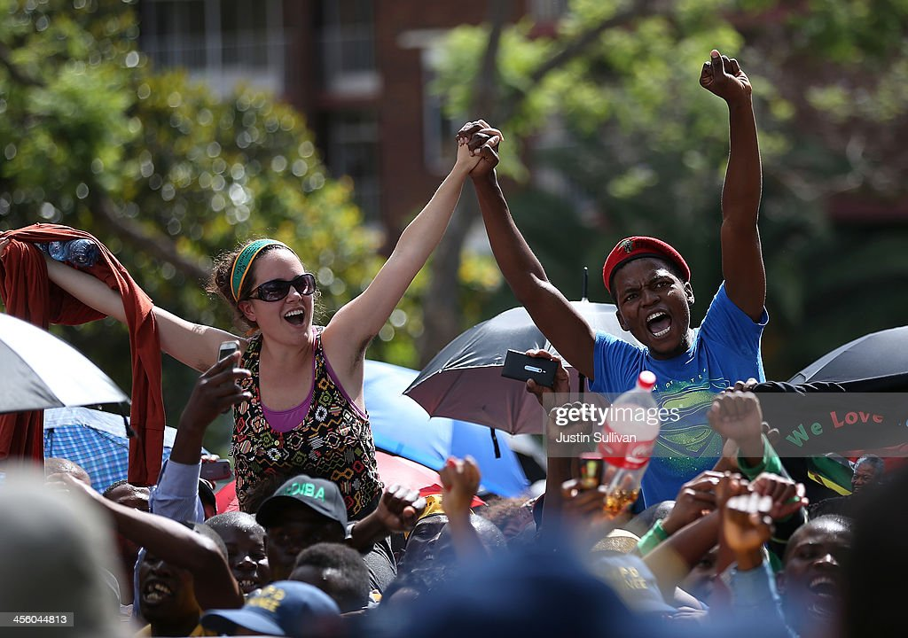 People protest outside of the Union Buildings after being told that they would not be allowed access to view the body of former South African president Nelson Mandela as he lies in state on December 13, 2013 in Pretoria, South Africa. Nelson Mandela's body will lie in state for three days as part of a week of events commemorating the life of former South African President. Mr Mandela passed away on the evening of December 5, 2013 at his home in Houghton at the age of 95. Mandela became South Africa's first black president in 1994 after spending 27 years in jail for his activism against apartheid in a racially-divided South Africa.