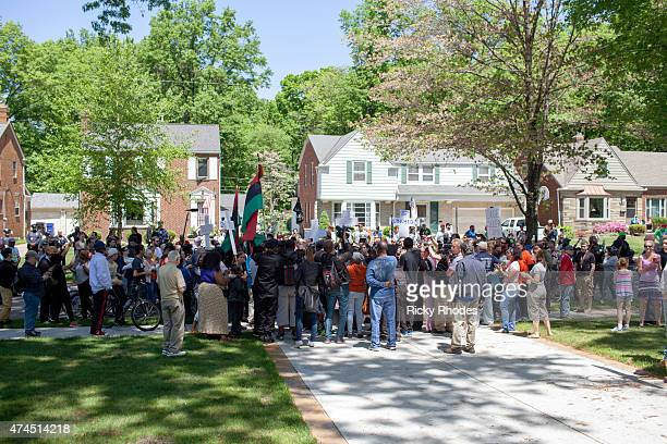 People protest outside the house of Prosecutor Timothy McGinty in reaction to Cleveland police officer Michael Brelo being acquitted of manslaughter...