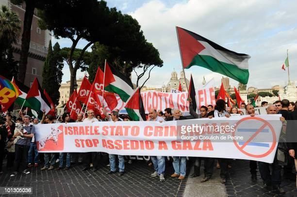 People protest outside the Italian Parliament against the Israeli storming of an aid ship heading for Gaza on May 31 2010in Rome Italy More than 10...