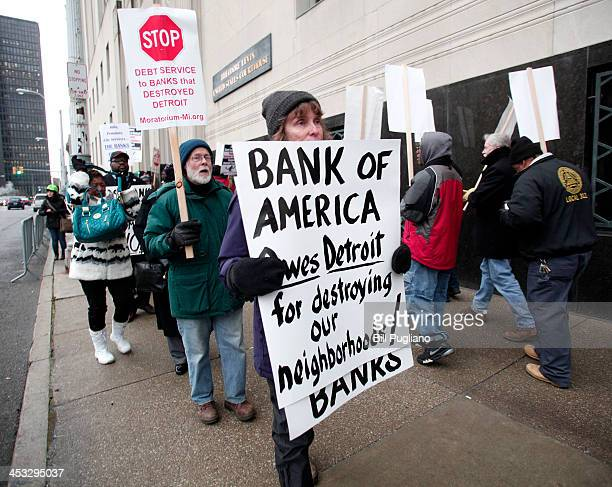People protest outside the US Courthouse where federal bankruptcy Judge Steven Rhodes is to rule on Detroit's Chapter 9 bankruptcy eligibility...