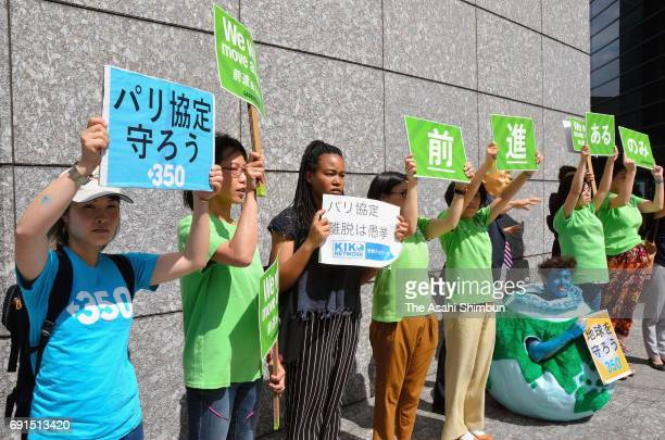 People protest outside the US Embassy on June 2 2017 in Tokyo Japan US President Donald Trump announced to withdraw from the Paris climate accord