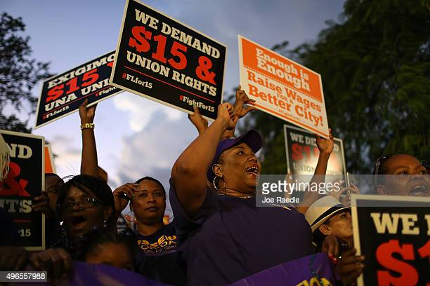 People protest together asking for a higher minimum wage on a National Day of Action on November 10 2015 in Miami Florida The protesters are...
