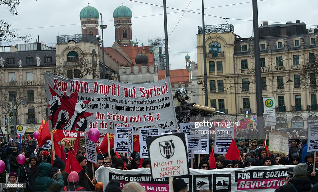 People protest with banners and signs during a rally against the 49th Munich Security Conference on February 2, 2013 in Munich, southern Germany. During the three day meeting world leaders, ministers and top military gather for talks with the spotlight on Syria, Mali and Iran.