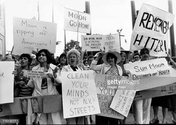 People protesting against Rev Sun Myung Moon's Unification Church circa 1976 in New York City