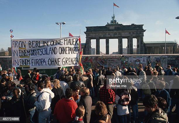 People protesting for the German reunification in front of the Brandenburg Gate on November 09 in Berlin Germany The year 2014 marks the 25th...