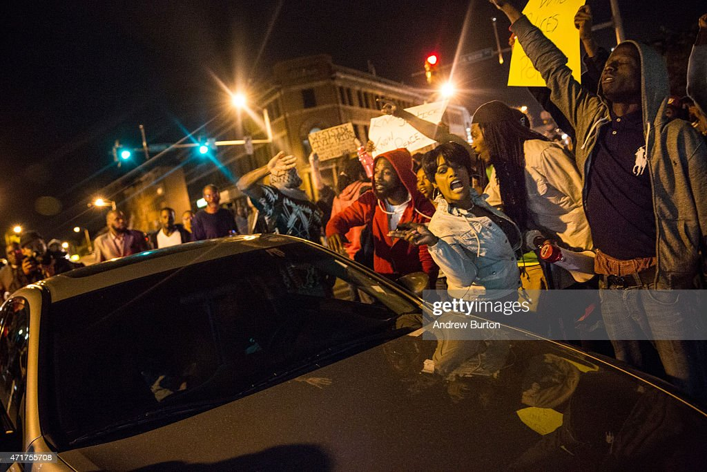 People protesting the death of Freddie Gray and demanding police accountability move into the streets in the Sandtown neighborhood where Gray was arrested on April 30, 2015 in Baltimore, Maryland. Gray, 25, was arrested for possessing a switch blade knife April 12 outside the Gilmor Houses housing project on Baltimore's west side. According to his attorney, Gray died a week later in the hospital from a severe spinal cord injury he received while in police custody.