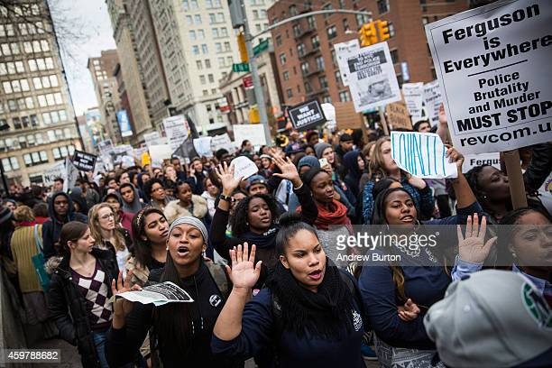 People protesting the Ferguson grand jury decision to not indict officer Darren Wilson in the Michael Brown case march through the streets on...