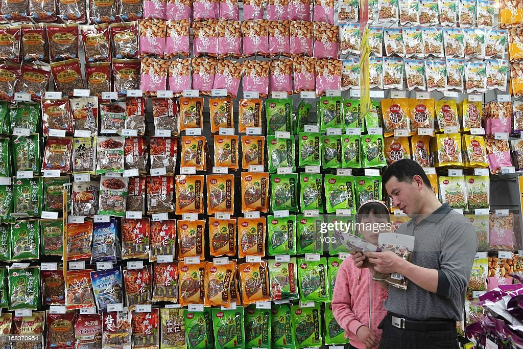 People purchase goods at a supermarket on May 9, 2013 in Ganyu, China. China's consumer price index (CPI), the main gauge of inflation, rose 2.4 percent year-on-year in April.