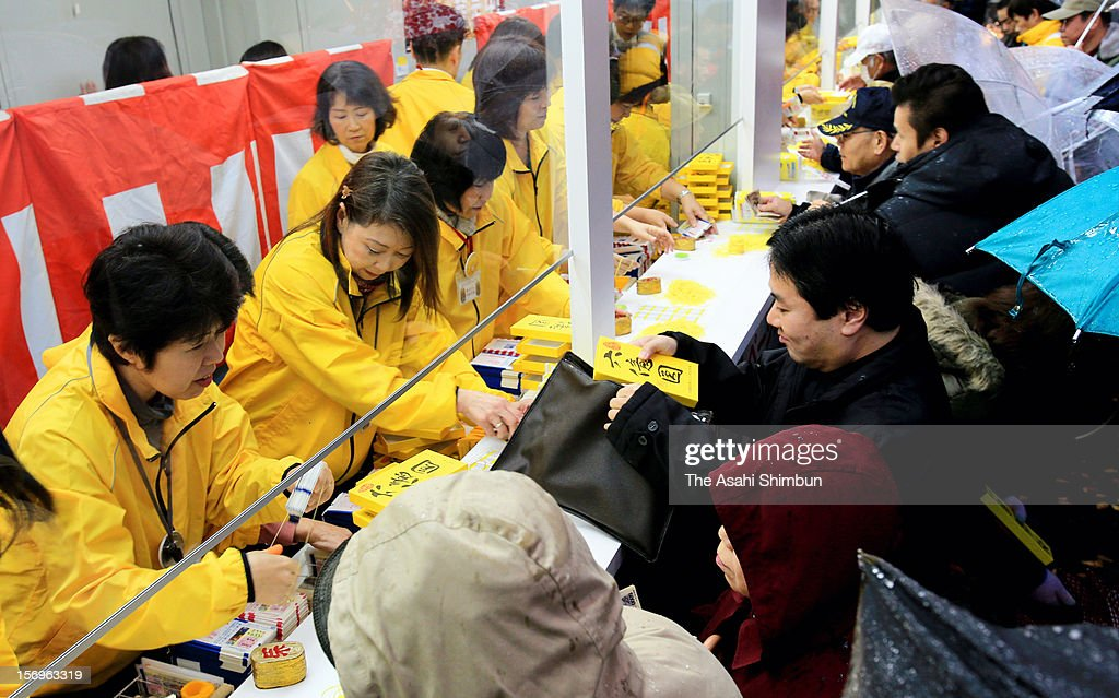 People purchase the Year End Jumbo Lottery, whose first prize will be 600 million Japanese yen (7.3 million U.S. Dollars) including the prizes for adjacent numbers, on November 26, 2012 in Osaka, Japan. The lucky number will be announced on December 31.