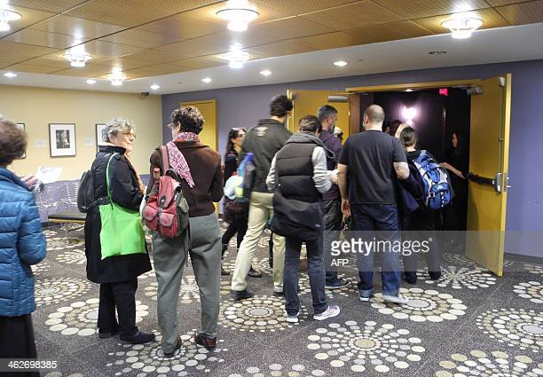 People purchase tickets at the Baruch Performing Arts Center in New York City ahead of a performance of the opera Thumbnail on January 14 2014...