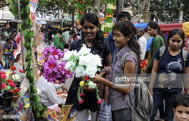 People purchasing decorative items for Diwali festival on October 18 2014 in Indore India Diwali the festival of light is celebrated by Hindus around...