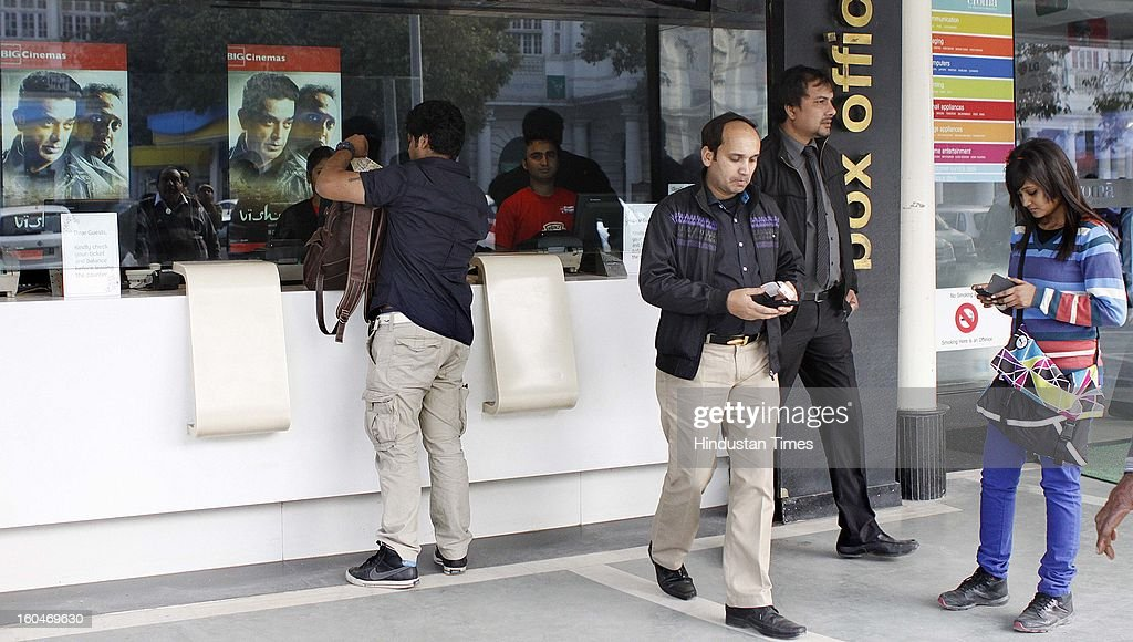 People purchasing tickets of Kamal Hassan's controversial film Vishwaroopam that was released in capital at Big Odeon Cinema hall amid security on...