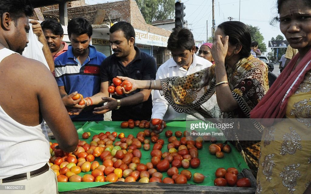 People purchasing vegetables as curfew was lifted temporarily for two hours on September 10, 2013 in Muzaffarnagar, India. No untoward incident was reported from Muzaffarnagar today as 975 people were arrested for their direct or indirect role in the communal violence that has left 35 dead.