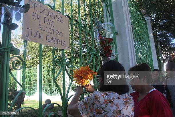 People put flowers in front of the house of Mexican singer Juan Gabriel in Ciudad Juarez Mexico on August 28 2016 Mexican singer composer and...