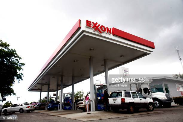People put gas in cars at an Exxon station July 31 2008 in Miami Florida Exxon Mobil reported July 31 2008 that the oil company's second quarter...