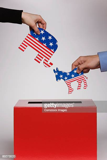 People putting political symbols in box