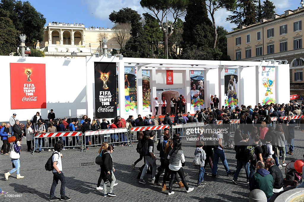 People queque in Piazza del Popolo to enter inside the FIFA World Cup Trophy Tour Village during day three of the FIFA World Cup Trophy Tour on February 21, 2014 in Rome, Italy.