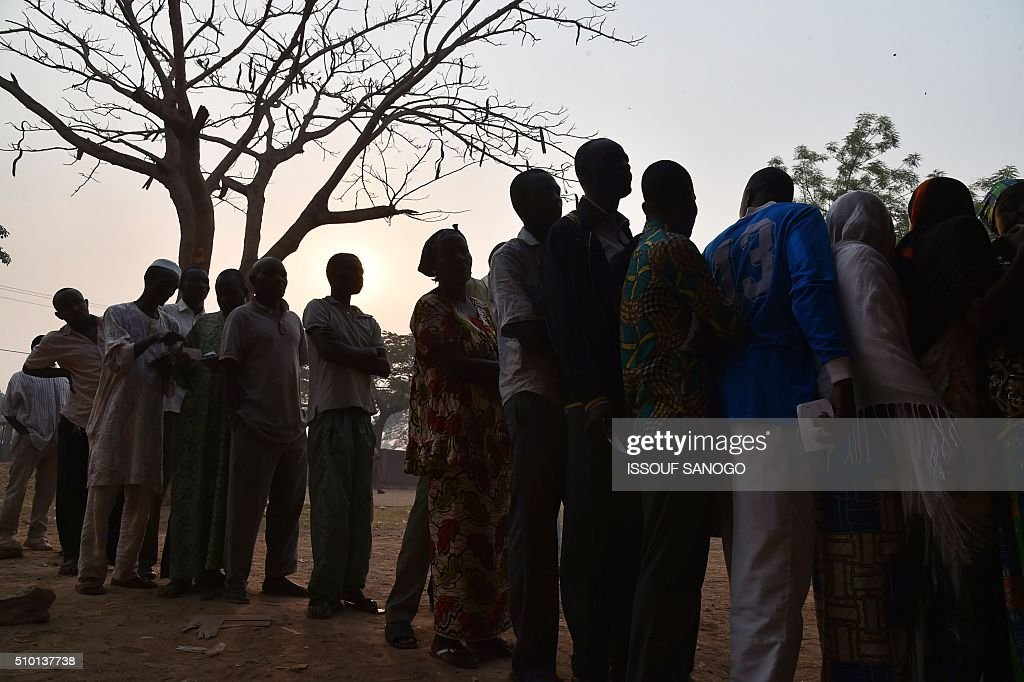 People queue at a polling station in the muslim district of PK 5 before voting on February 14, 2016 as people go to the polls to take part in the Central African Republic second round of the presidential and legislative elections. Voters in the Central African Republic began casting ballots on February 14 in delayed legislative elections and a presidential run-off which they hope will bring peace after the country's worst sectarian violence since independence in 1960.The nation, dogged by coups, violence and misrule since winning independence from France, could take a step towards rebirth if the polls go smoothly. SANOGO