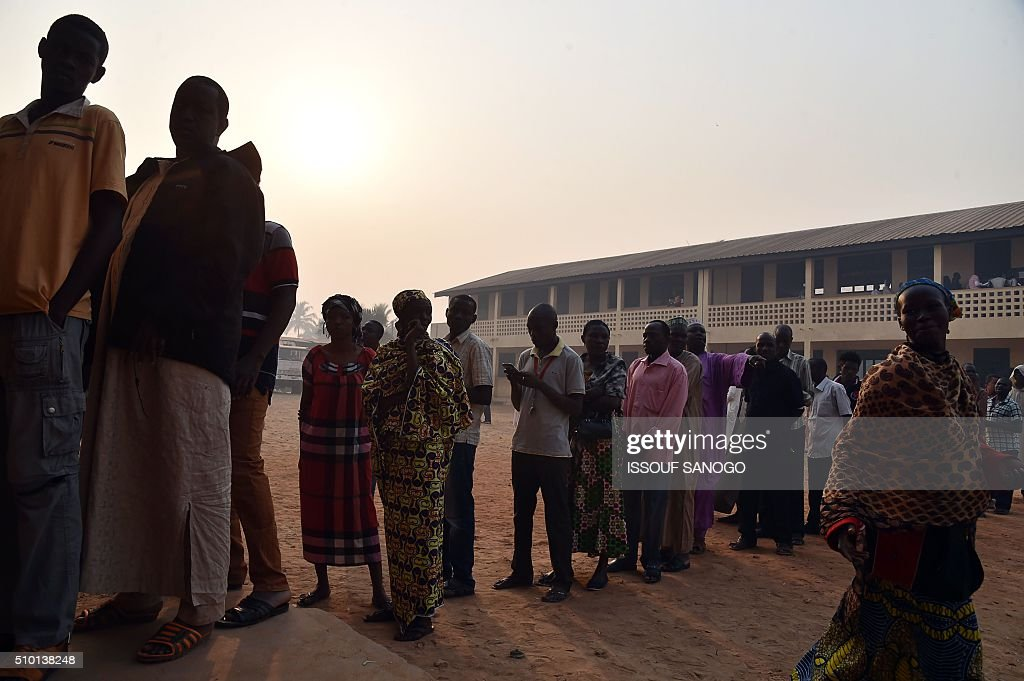 People queue at a polling station in the muslim district of PK 5 in Bangui before voting on February 14, 2016 as people go to the polls to take part in the Central African Republic second round of the presidential and legislative elections. Voters in the Central African Republic began casting ballots on February 14 in delayed legislative elections and a presidential run-off which they hope will bring peace after the country's worst sectarian violence since independence in 1960.The nation, dogged by coups, violence and misrule since winning independence from France, could take a step towards rebirth if the polls go smoothly. SANOGO