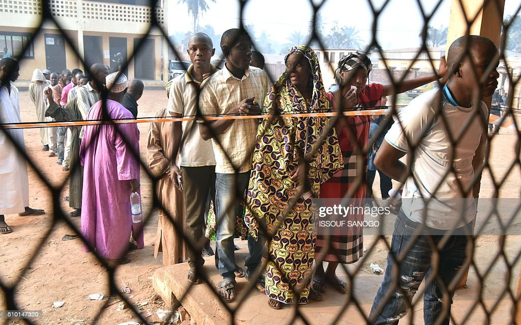 People queue at a polling station in the muslim district of PK 5 in Bangui before voting on February 14, 2016 as people go to the polls to take part in the Central African Republic second round of the presidential and legislative elections. Voters in the Central African Republic began casting ballots on February 14 in delayed legislative elections and a presidential run-off which they hope will bring peace after the country's worst sectarian violence since independence in 1960.The nation, dogged by coups, violence and misrule since winning independence from France, could take a step towards rebirth if the polls go smoothly. / AFP / ISSOUF SANOGO