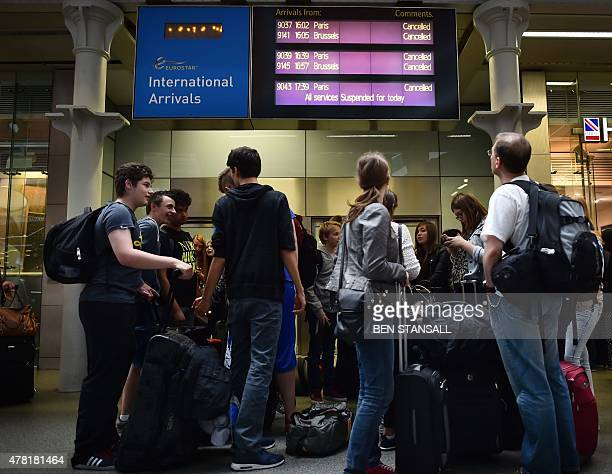 People queue at the Eurostar terminal at St Pancras station in London on June 23 2015 after all services were cancelled due to a protest on the...
