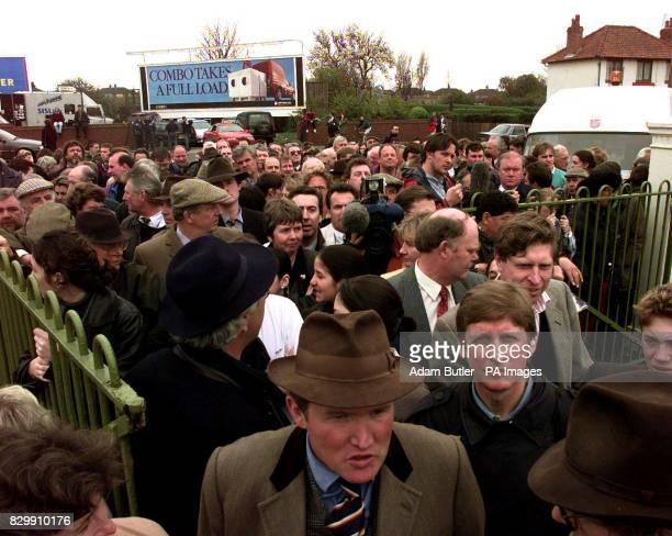 People queue at the gates of Aintree as they are still not allowed in to get their cars and personal belongings out this afternoon Photo by Adam...