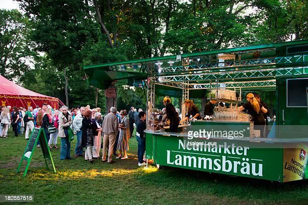 People queue for beer in Stadtpark city park