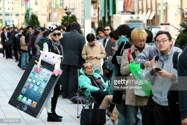 People queue for purchasing Apple's iPad Mini in front of Apple Store Ginza on November 2 2012 in Tokyo Japan