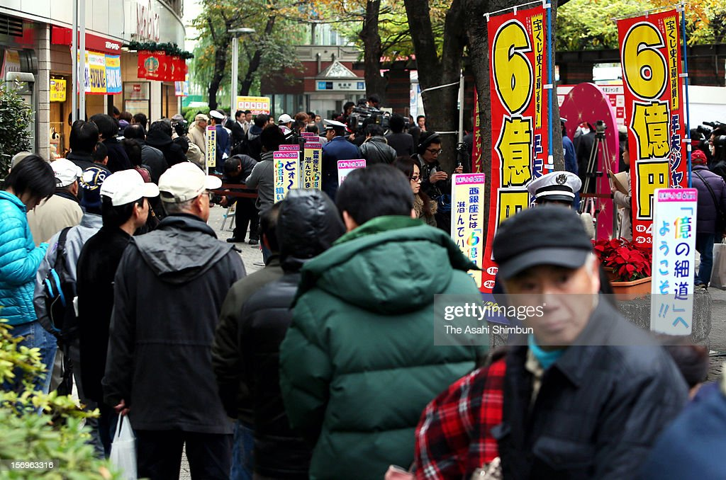 People queue for purchasing the Year End Jumbo Lottery, whose first prize will be 600 million Japanese yen (7.3 million U.S. Dollars) including the prizes for adjacent numbers, on November 26, 2012 in Tokyo, Japan. The lucky number will be announced on December 31.