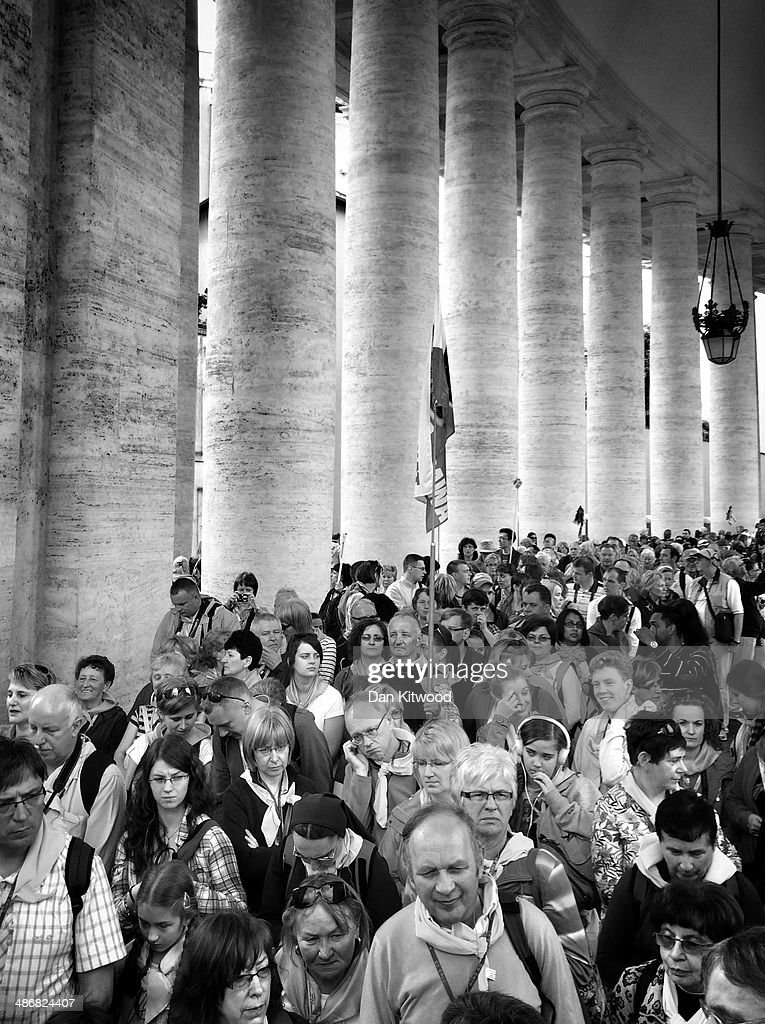 People queue for St Peter's Basilica in St Peter's Square on April 26, 2014 in Vatican City, Vatican. Dignitaries, heads of state and Royals, from Europe and across the World, are gathering in the Vatican ahead of tomorrow's canonisations. The late Pope John Paul II and Pope John XXIII will be canonised on Sunday 27 April, inside the Vatican when 800,000 pilgrims from around the world are expected to attend.