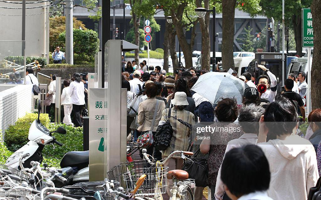 People queue for the court seats of Tatsuya Ichihashi, who had been indicted for murdering British teacher Linsay Ann Hawker at the Chiba District Court after the suspect Tatsuya Ichihashi was sentenced life in prison on July 21, 2011 in Chiba, Japan. Ichihashi was arrested in 2009 after the 2-and-half-year runout, having plastic sergery to escape.