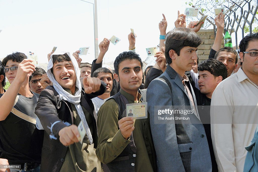 People queue for the vote at a polling station on June 14, 2014 in Kabul, Afghanistan. Polling stations have opened across Afghanistan as Afghans head to the polls for the second and final round of voting to elect Hamid Karzai's successor, in a run-off between former foreign minister Abdullah Abdullah and former World Bank economist Ashraf Ghani.