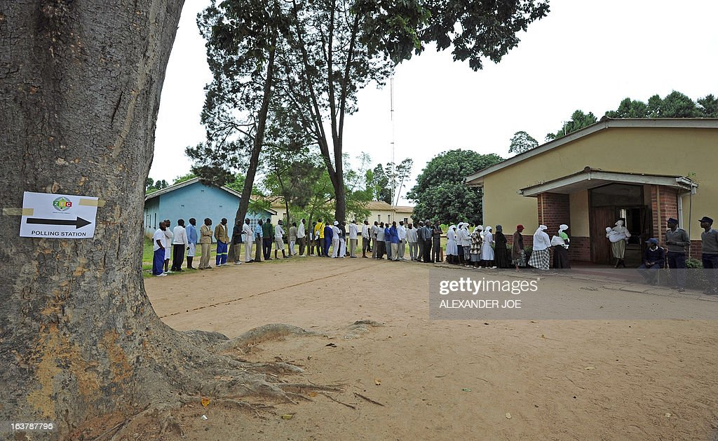People queue in front of a polling station in a school in Chitungwiza, on March 16, 2013, as voting kicked off for Zimbabwean referendum for a new constitution designed to underpin democratic reforms.