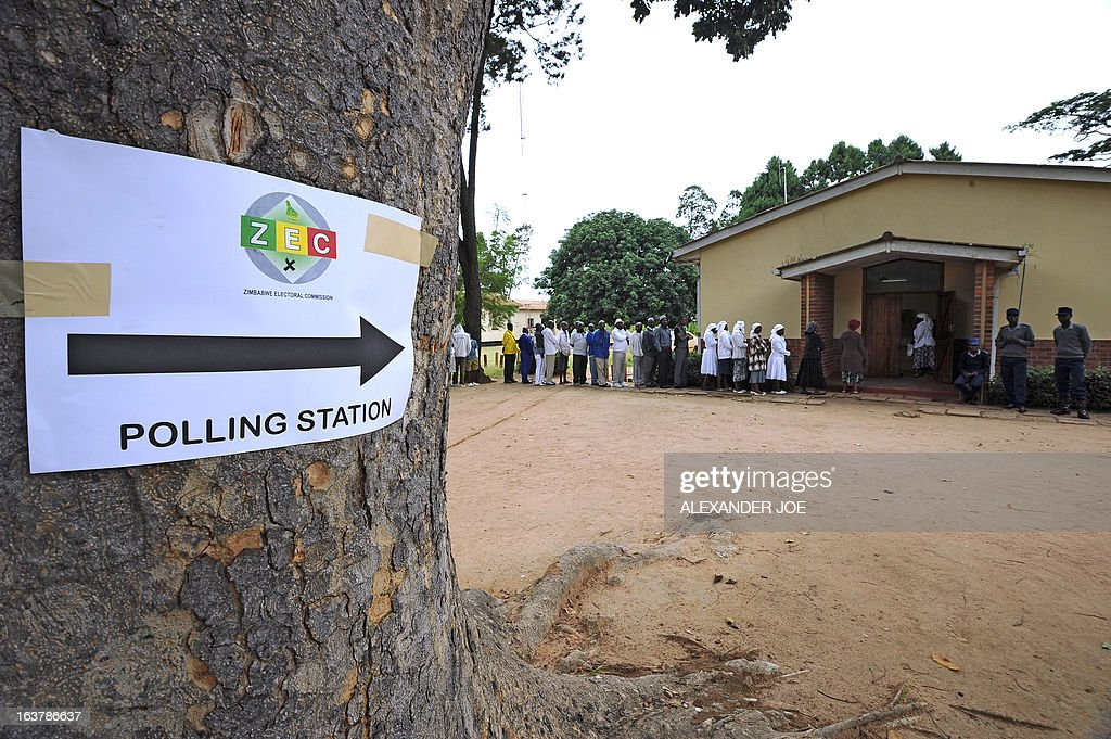 People queue in front of a polling station in Chitungwiza, on March 16, 2013, as voting kicked off for Zimbabwean referendum for a new constitution designed to underpin democratic reforms.