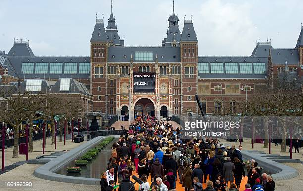 People queue in front of the museum on the day the official reopening of the Rijksmuseum in Amsterdam on April 13 2013 The museum opens its doors to...