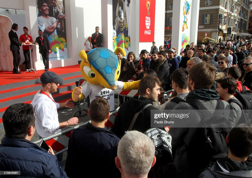 People queue in Piazza del Popolo to enter the FIFA World Cup Trophy Tour Village during day three of the FIFA World Cup Trophy Tour on February 21, 2014 in Rome, Italy.